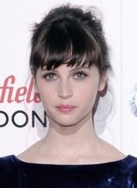 http://www.look.co.uk/pictures/celebrity-hairstyle-trend-fringes/felicity-jones-adds-interest-to-her-bun-hairstyle-with-a-