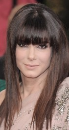 http://www.look.co.uk/pictures/celebrity-hairstyle-trend-fringes/sandra-bullock-wows-at-the-golden-globe-awards-with-a-fie