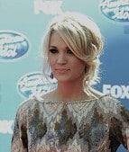 http://www.stylebistro.com/Celebrity+Clothes/articles/cc5kli7xtRn/Carrie+Underwood+Gets+Short+Short+Beaded+Art
