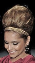 http://www.contactmusic.com/news/cheryl-cole-debuts-bizarre-marge-simpson-hair_1246138