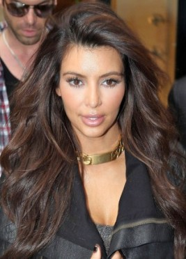 http://www.stylebistro.com/Celebrity+Hair/articles/xCb0BdM3BRP/Kim+Kardashian+Wears+Hair+Long+Wavy+Paris